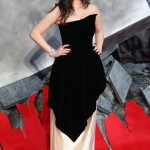 "Dennings stepped onto the red carpet of the world premiere of ""Thor: The Dark World"" in a dramatic black velvet and shiny cream dress. (Photo: WENN)"