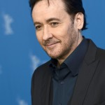 """From his role as Gordie's older brother, Denny, to his iconic role as hopeless romantic Lloyd in """"Say Anything,"""" John Cusack will forever be our celebrity crush. (Photo: WENN)"""