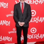 The Netflix star stayed in theme with Target's Wonderland launch wearing a polka dotted red tie paired with a button-up shirt, dark grey suit jacket and black pants. (Photo: WENN)