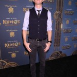 Neil posed at the Cirque du Soleil Kurios Cabinet opening wearing a light blue button up, loose dark tie and navy vest, paired with washed grey pants. (Photo: WENN)