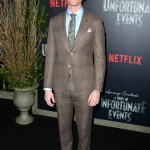 Neil Patrick Harris arrived at the screening of his Netflix series wearing a blue button-up, blue tie with gold floral detailing and brown checkered suit. (Photo: WENN)