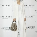 Emily screamed chic in a head-to-toe white ensemble paired with a snakeskin-patterned purse at the Twinset Simona Barbieri photocall. (Photo: WENN)
