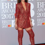 Nicole Scherzinger opted for a radical image overhaul at the 2017 BRIT Awards wearing a red blazer dress and matching thigh high boots combo. (Photo: WENN)