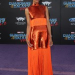 Zoe Saldana arrived at the Guardians of the Galaxy 2 world premiere in a bright, fun zesty orange sequined and fringe dress by Emilio Pucci. (Photo: WENN)