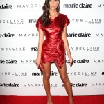 Emily Ratajkowski turned heads as she walked onto the red carpet of Marie Claire's Fresh Faces event in a futuristic shimmery red dress by Roberto Cavalli. (Photo: WENN)