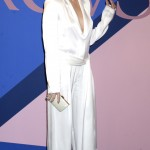 Adriana Lima looked chic in a slouchy white silk jumpsuit by Urban Zen at the CFDA Fashion Awards 2017. (Photo: WENN)