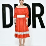Portman hit Tokyo for the Dior for Love photo call in a boho-inspired red dress by the French house. (Photo: WENN)