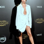 Ratajkowski opted for a revealing white shirt dress by Jacquemus at the Vogue Party during Paris Fashion Week 2017. (Photo: WENN)