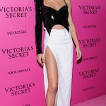 The Victoria's Secret angel rocked a sparkly sequined black top and a floor-length split white skirt by Mugler at show's after party. (Photo: WENN)