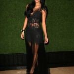 Nicole Scherzinger stunned in a flesh-flashing black lacy gown with floor-length lace skirt at the 2018 Golden Globes red carpet. (Photo: WENN)
