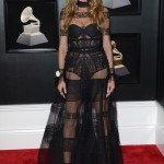 Heidi arrived at the 2018 Grammys in a high neck lace dress with sheer paneling by Ashi Studio, accessorized with strappy black heels. (Photo: WENN)