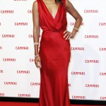 """Zoe made a statement at the world premiere of her movie """"The Legend of Red Hand"""" in a scarlet v-neck low back dress by Alberta Ferretti. (Photo: WENN)"""