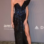 Heidi Klum flashed toned thighs and ample bust in a sexy black dress with embroidered blue jewels by Versace at the 2018 amfAR gala. (Photo: WENN)