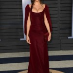 The model arrived to the Vanity Fair 2018 Oscars party wearing a custom burgundy velvet gown with cape by Zac Posen. (Photo: WENN)