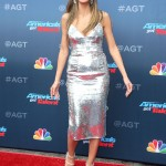 The model showed off her flawless physique in a shimmering silver gown Alex Perry at the AGT Season 13 kickoff red carpet. (Photo: WENN)