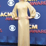 Nicole Kidman grabbed the spotlight at the 2018 ACMA Awards wearing a long sleeved, high neck shimmering sequined gold gown by Michael Kors. (Photo: WENN)
