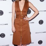 Lucy Hale attended Beautycon NYC 2018 donning a camel-colored sleeveless cargo dress from DVF with zip fastening and flap pockets. (Photo: WENN)