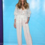Heidi revealed some cleavage wearing a silver stitched sequins button-front shirt and wide leg pants by Sally LaPointe at NBCUniversal's Summer Press Day. (Photo: WENN)