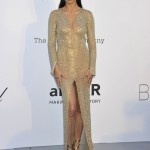 Adriana sparkled at the 2018 amfAR gala in a body-hugging, thigh slit, simmering gold Julien Macdonald dress. (Photo: WENN)