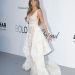 Heidi Klum stunned in a white Zuhair Murad gown with a plunging neckline at the red carpet of the 2018 amfAR Gala in Cannes. (Photo: WENN)