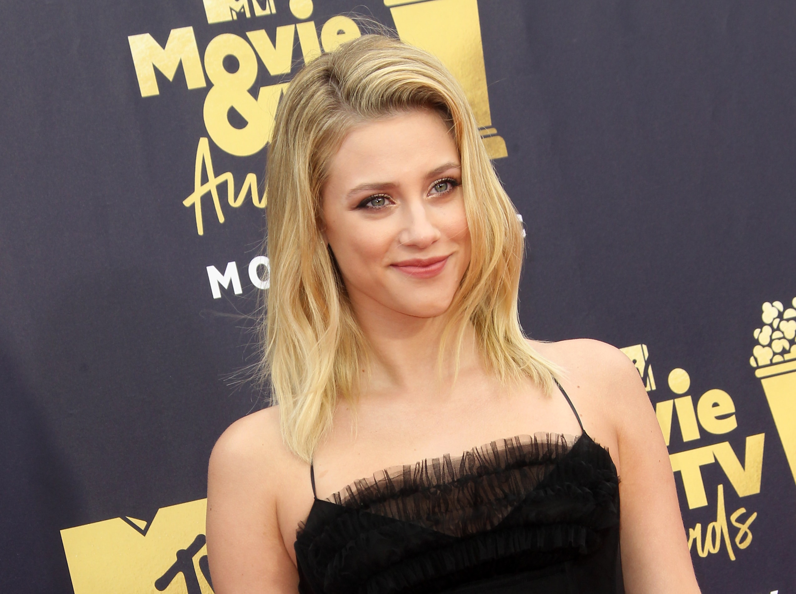 Lili Reinhart is clapping back at haters who are invalidating her body dysmorphia. (Photo: WENN)