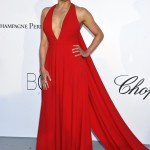 Michelle Rodriguez was all smiles in a plunging halter-neck bright red dress with long trail at the 2018 amfAR Gala at the Cannes Film Festival. (Photo: WENN)