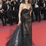 "The actress attended the screening of ""Solo: A Star Wars Story"" at Cannes in a semi-sheer sparkly black gown boasting an eye-catching tulle trail. (Photo: WENN)"