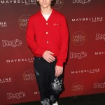 "The youngster brought his A-fashion game at the 5th annual People Magazine ""Ones To Watch"" party wearing a button-up red cardigan and oversized navy pants with floral print. (Photo: WENN)"