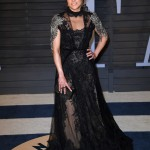 Michelle Rodriguez went for a gothic inspired look at the 2018 Vanity Fair Oscar Party wearing a lace black dress with silver appliqués on the shoulders. (Photo: WENN)