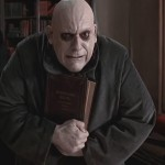 Uncle Fester from The Adams Family is not a with, but still able to illuminate light bulbs with his mouth! I think I'm a total Uncle Fester—loveable, pale, and easily manipulated by Joan Cusack. (Photo: Release)