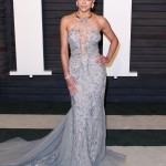 The actress showed off her toned arms at the 2016 Vanity Fair Oscars party in a formfitting sheer halter gown with gorgeous beaded detailing. (Photo: WENN)