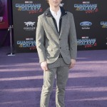 "Oleff attended the premiere of ""Guardians of the Galaxy Vol. 2"" a matching grey cotton suit on top of a navy hoodie, white button up shirt and matching sneakers. (Photo: WENN)"