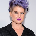Kelly Osbourne kept things fun and matched her iconic lavender hair with an eye-catching bold purple matte lipstick at the 2014 NBC and Universal upfronts event. (Photo: WENN)