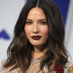Olivia Munn amped up her otherwise very natural, minimal makeup at the 2017 VMA's red carpet with a rich brownish burgundy matte lipstick. (Photo: WENN)
