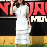 "The actress looked super feminine in a lovely white mesh lace midi dress by Self Portrait at the red carpet of the ""LEGO Ninjago Movie"" premiere. (Photo: WENN)"