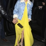 The pop sensation was seen out and about in New York wearing a vibrant long flowy yellow dress with matching heels and a light blue jean jacket with fur collar. (Photo: WENN)