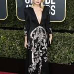 The actress supported the Time's Up movement at the 2018 Golden Globes red carpet in a plunging long-sleeved embellished gown by Gucci. (Photo: WENN)