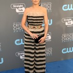 Margot walked the blue carpet at the Critics' Choice Awards 2018 in a striped black and gold number by Hamburglar featuring a jeweled waistline. (Photo: WENN)