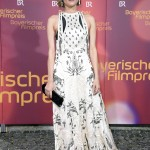 The actress attended the Bayerischer Filmpreis 2018 in a beautiful white A-line Valentino gown with delicate floral embroidered detailing in black. (Photo: WENN)