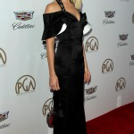 Margot Robbie wowed in a Louis Vuitton black silky gown with a sweetheart neckline and statement sleeves at the 218 Producer's Guild Awards. (Photo: WENN)