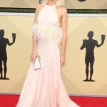 Margot hit the red carpet at the 2018 SAG Awards in a heavenly pink halterneck dress by Miu Miu featuring a feathered trim around her waist and. (Photo: WENN)