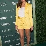 "The ""X-Men"" actress lightened up the CFDA, Variety and WWD runway celebrating American designers in a lemon-yellow lace-up outfit by Veronica Beard Bentley. (Photo: WENN)"