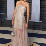 """The """"I, Tonya"""" actress made it to the best dressed list in a sparkling silver Chanel gown with see-through skirt at the Vanity Fair Oscar Party 2018. (Photo: WENN)"""