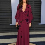 Olivia smoldered in a plunging sangria-colored Cavalli dress with voluminous sleeves, adorned with delicate floral appliqués at the 2018 Vanity Fair Oscar Party. (Photo: WENN)