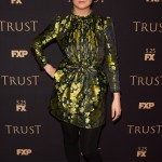 Billie Lourd struck a post at the 2018 FX Annual All-Star Party wearing a Gucci long sleeve dress with rich gold and navy floral brocade and hunter green velvet heels. (Photo: WENN)