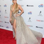 Jennifer Lopez amped up the glamour at the Time 100 gala wearing a plunging dress by Zuhair Murad with gold leaf embroidery detailing and a revealing thigh-high slit. (Photo: WENN)