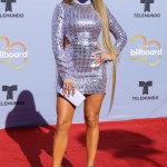 Jenny from the block's cascading hair looked even more spectacular next to her disco ball-inspired silver and lilac high neck David Koma minidress with daring cut outs on the sides. (Photo: WENN)