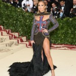 JLo was a vision from heaven at the 2018 Met Gala wearing a completely bejeweled Balmain dress with an ostrich feather-covered skirt and thigh-high slit. (Photo: WENN)