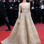 "The Portuguese beauty shined at the Cannes premiere of ""Girls of the Sun"" in an off-the-shoulders gown with gold checked pattered designed by Zuhair Murad. (Photo: WENN)"