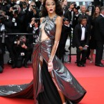 Winnie Harlow amped up the glamour at the De Grisogono Party at Cannes 2018 in an Ellie Saab red gown with intricate lace bodice and column skirt with a split up the front. (Photo: WENN)